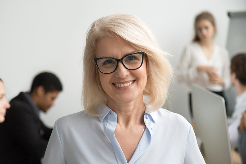 smiling older glasses patient