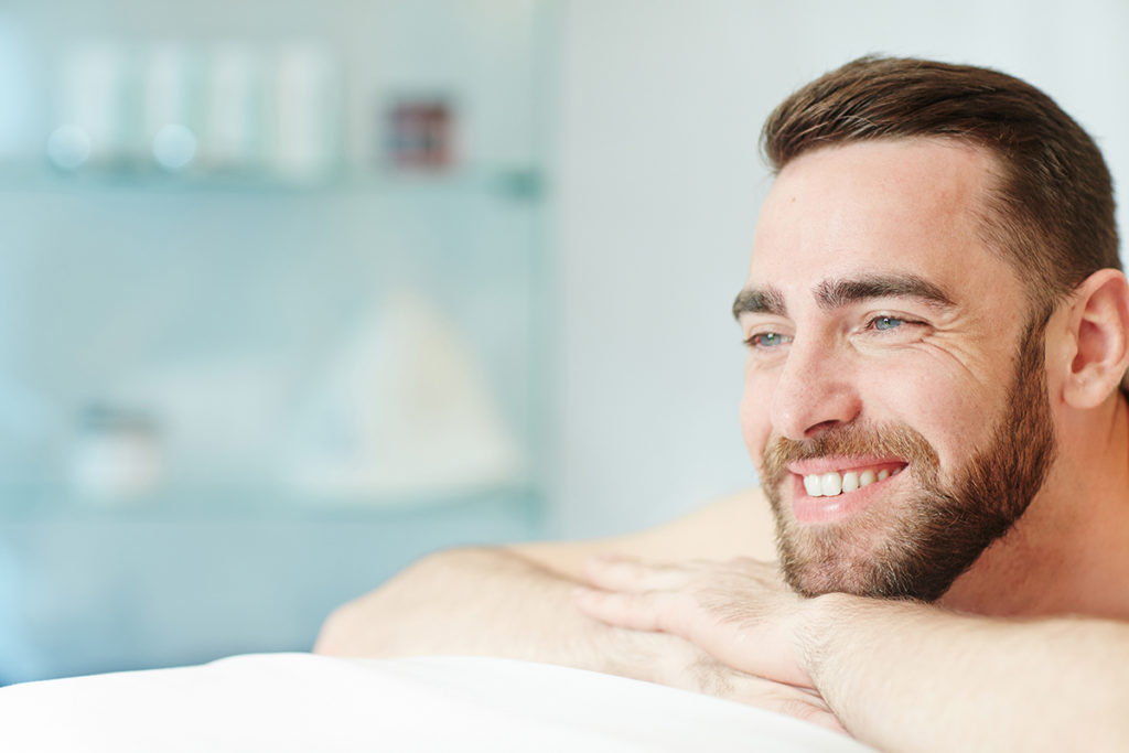 man relaxing at aesthetic center