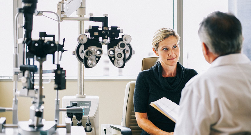 eye doctor consulting patient
